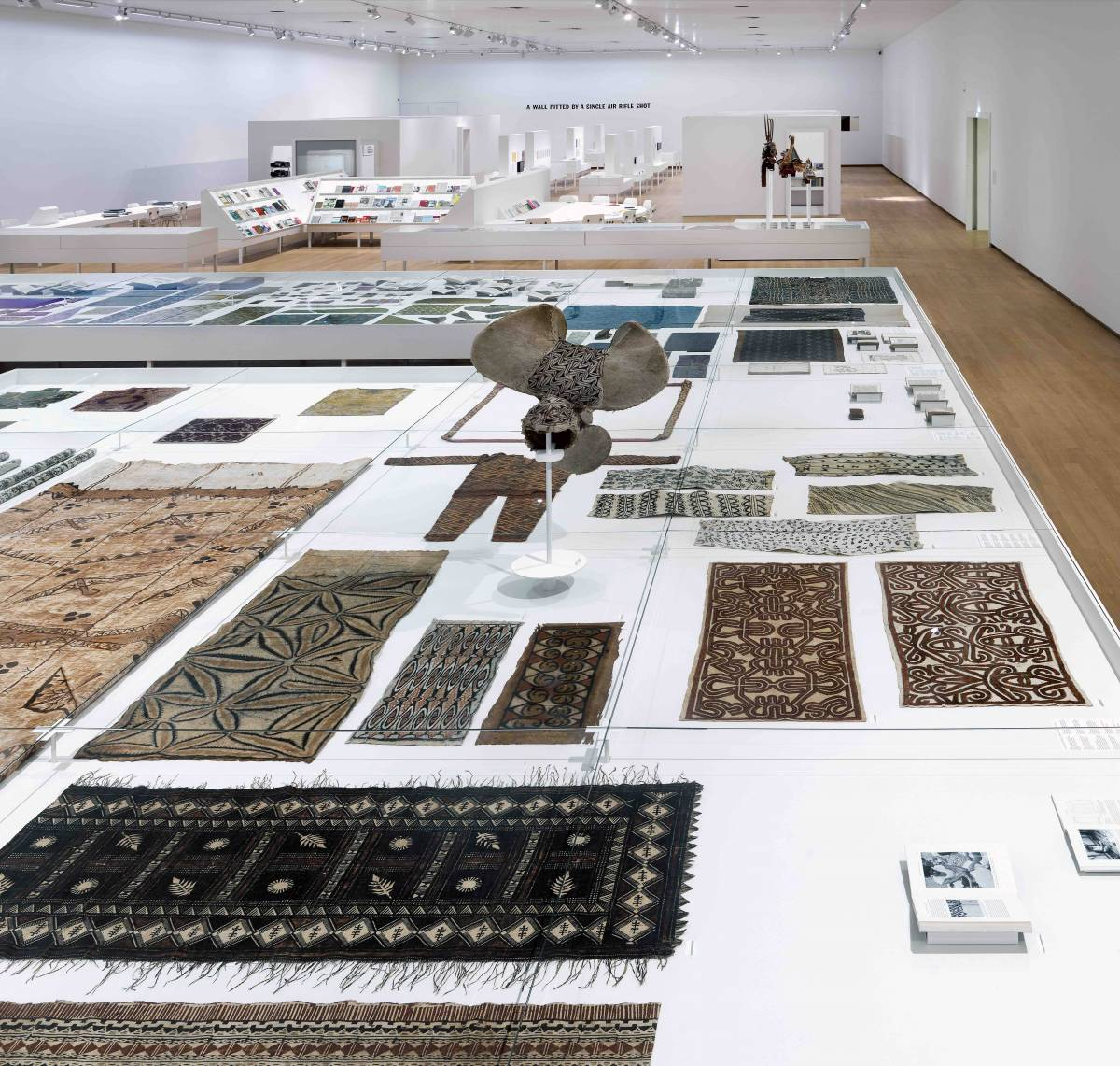 Installation view with in front selection from the SST textile collection,  Seth Siegelaub – Beyond Conceptual Art, Stedelijk Museum, Amsterdam, December 2015 – April 2016